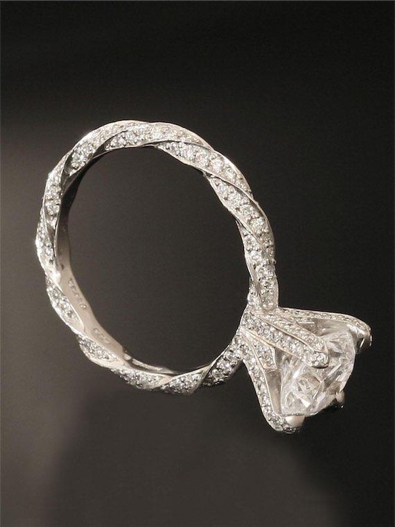Platinum Infinity 0.18k Diamond Twist Princess Cut Engagement Ring
