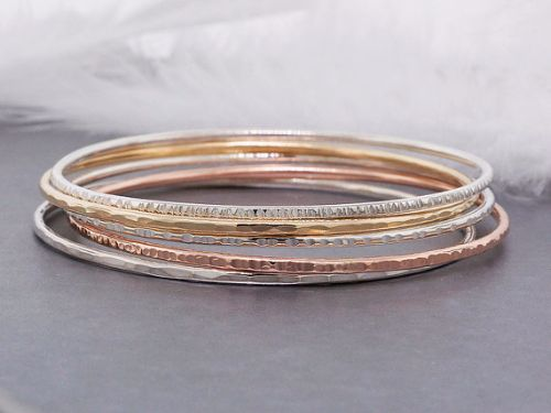Silver And Rose Gold Bracelets
